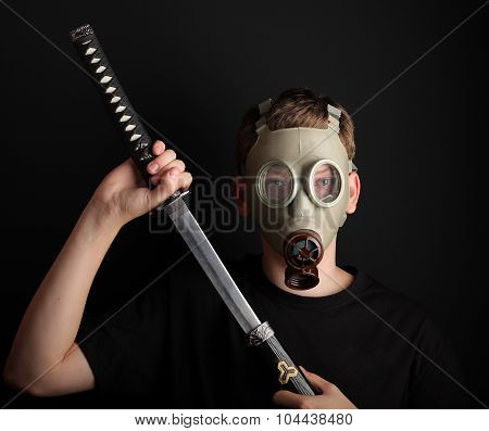Man With Gas Mask And  Katana Sword On Black  Background