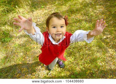 Little girl giving a hug