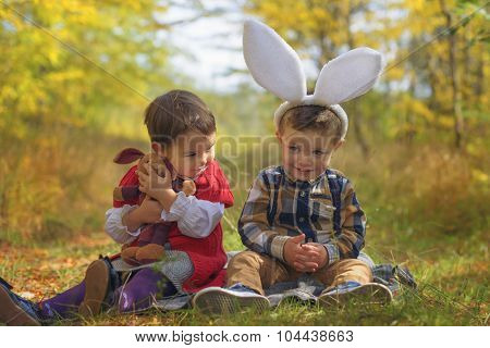 Two Little Kids Playing Like Bunnies