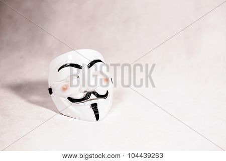 white anonymous mask on white background, face