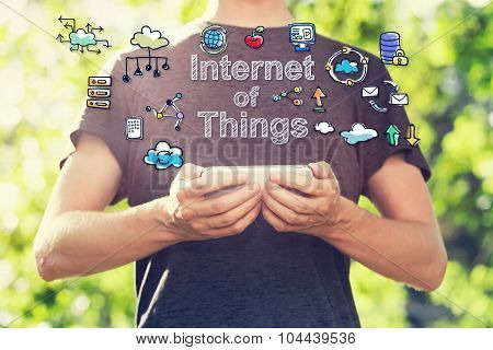 Internet Of Things Concept With Young Man Holding His Smartphone