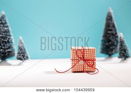 Little Gift Box In Miniature Evergreen Forest