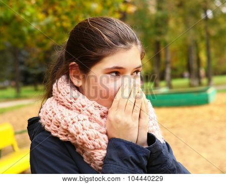 Teen Pretty Girl Warm Bare Hands With Breath