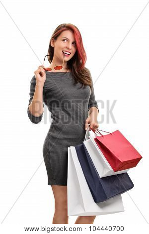 Girl With Glasses And Shopping Bags