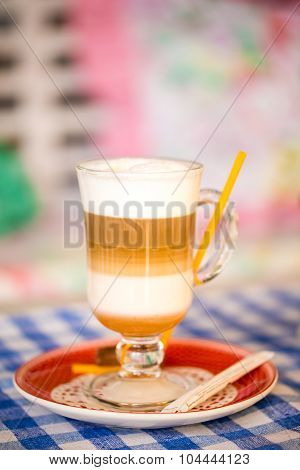 Beautiful Cappuccino, Latte,coffee In A Glass Cup On A Checkered Tablecloth