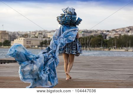 Models Walk An During  Outdoor Fashion Show With Clothing Made Out Of Recycled Materials Was Held In