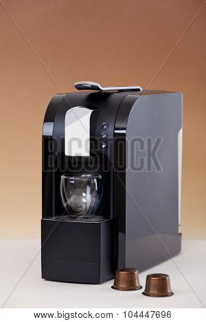Espresso machine with coffee pods on the side