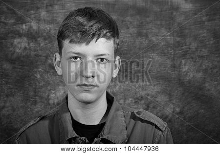 Young Man In Studio On Batik Background