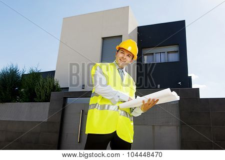 Young Attractive Foreman Worker Supervising Building Blueprints Smiling Happy Outdoors