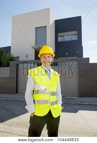 Foreman Worker Standing In Front Of New Building Project  Outdoors Wearing Construction Helmet