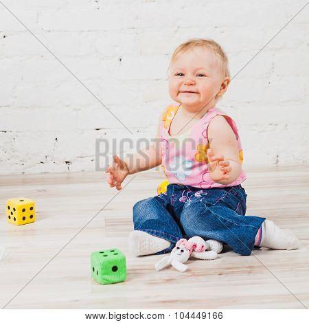 Happy baby sitting on floor