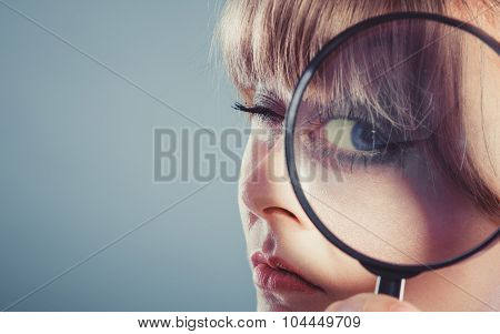 Woman Hand Holding Magnifying Glass On Eye
