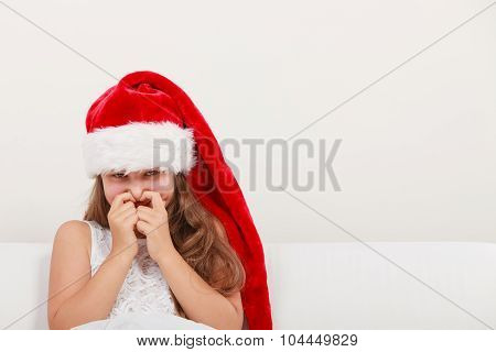 Little Girl Kid In Santa Hat Giggling. Christmas.