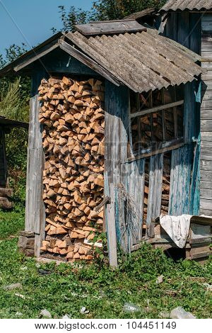 Firewood shed filled with firewood.