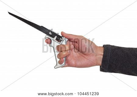 Hand holding a saw