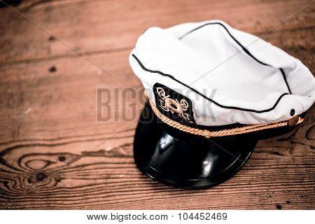 sailor's cap on the wooden floor - for kids