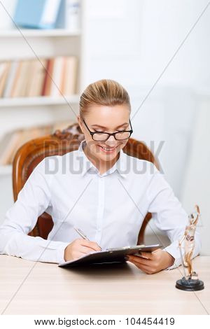 Charming lawyer sitting at the table