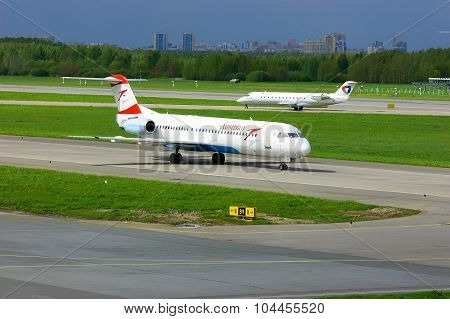 Austrian Airlines Fokker 100 And Severstal Canadair Crj-200 Aircrafts In Pulkovo International Airpo