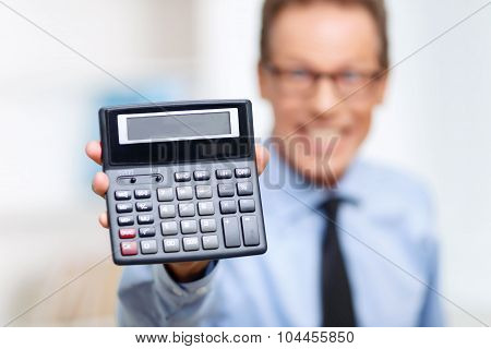Professional lawyer holding calculator