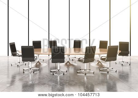 Conference Room With Round Wooden Table, Chairs And Concrete Floor