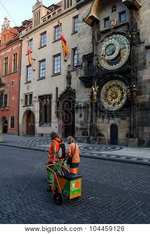 Street Janitors On Shift Near Astronomic Clock Tower