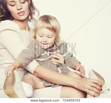 pretty real fashion mother with cute blond little daughter close up