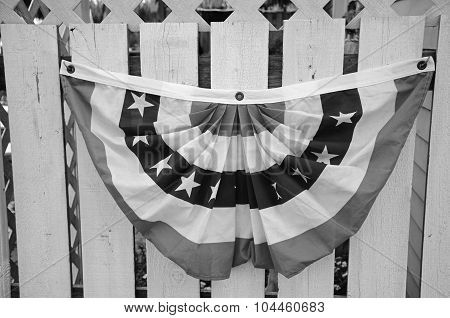 Bunting on a picket fence