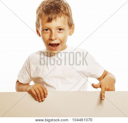 little cute boy holding empty shit to copyspace isolated close up gesturing