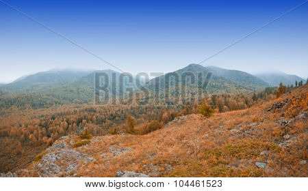 taiga and mountains in beauty autumn morning