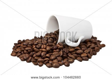 Coffee grains in a white cup and disseminated about a coffee pot on a isolated background