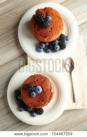 Cakes with berries on the table