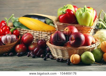 Heap of fresh fruits and vegetables on table close up