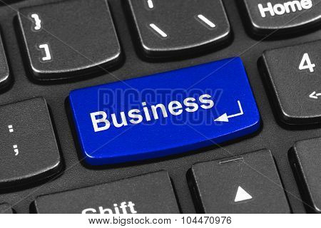 Computer notebook keyboard with Business key - technology background