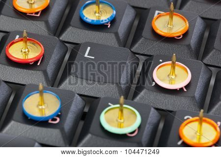 Pins on computer keyboard - concept background