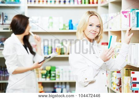 pharmacist chemist woman working in pharmacy drugstore with doctor prescription