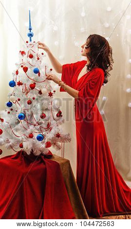 Girl In Red Dress Decorated With Christmas Tree.