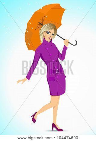 friendly woman holding an umbrella