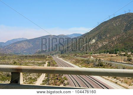 View of mountains and a road from the bridge