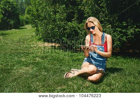 Happy Young Blonde Woman College Student Use Tablet Pc Sit On Gr