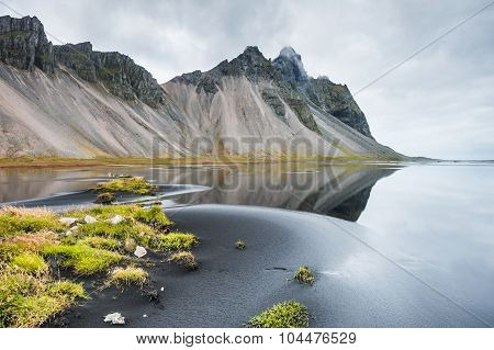 Beautiful Landscape With Mountains And Reflection On The Coast Of The Atlantic Ocean