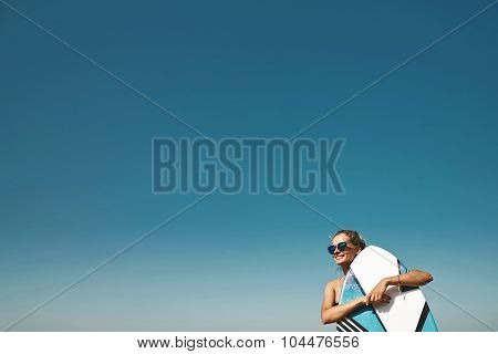 Beautiful Professional Surfer Girl Standing And Relaxing After Surfing Sitting Against  Copy-space S