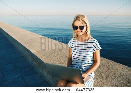 Beautiful Young Woman Sitting On Beach With Laptop Smiling And C