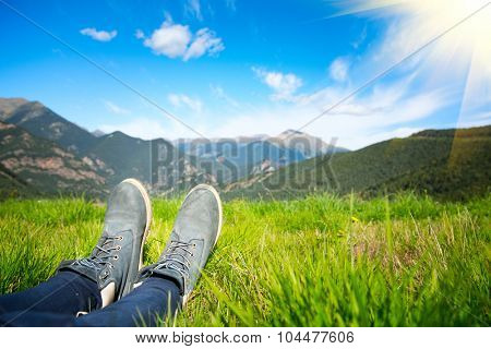 Hiker enjoying the view of nature. Beautiful lanscape with meadow and mountains. Tourism, sport, healthy lifestyle concept
