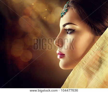 Beautiful fashion Indian woman profile portrait with oriental accessories. Indian girl with beauty jewels. Hindu model with perfect make-up. India