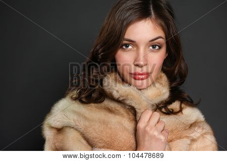 Portrait of a beautiful woman in  jacket with fur.