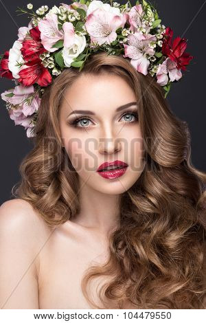 beautiful blond girl with curls and wreath of purple flowers on her head. Beauty face.