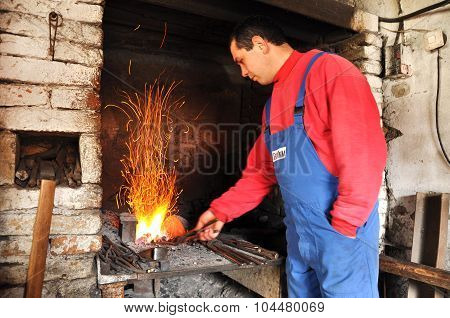 Blacksmith Working On An Object In The Hot Coal