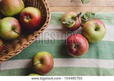 Fresh organic apples, on wooden table