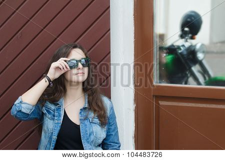 City Portrait Of Motorcyclist Biker Young Woman With Black Mirror Sunglasses Near Green Motorcycle B