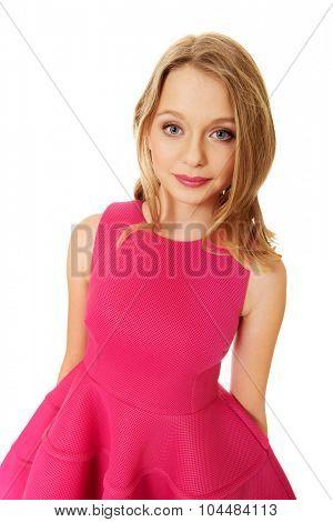 Beautiful teenage woman with pink skirt
